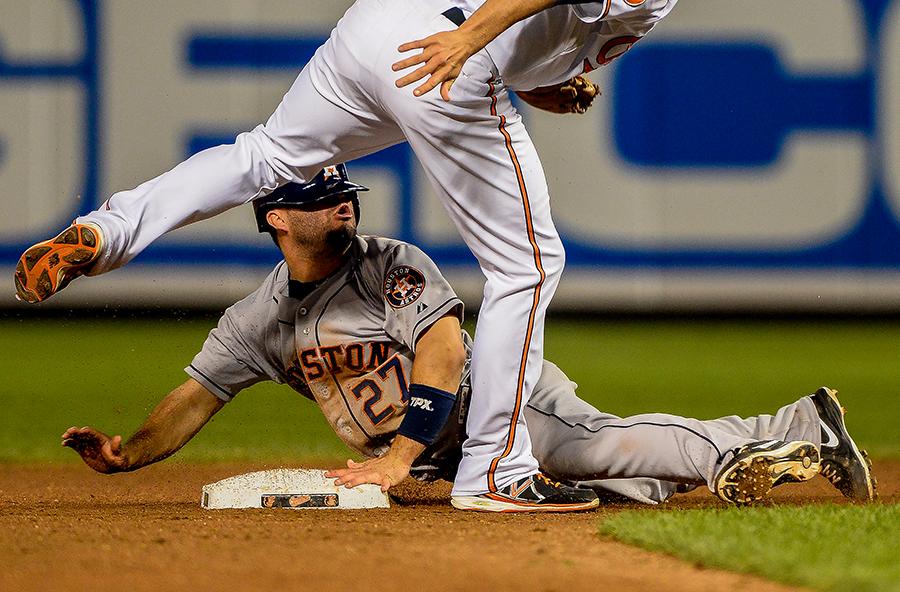 Houston Astros second baseman Jose Altuve slides into second base.