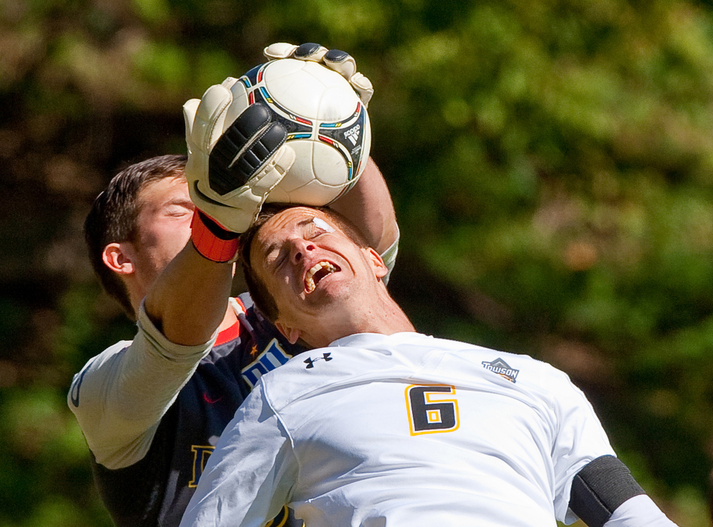 Towson University men's soccer defenseman, Daniel Grundei, attempts to take the game into overtime with a diving header on Oct. 13, 2012 in Baltimore, Md.