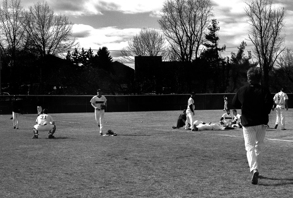 The Towson University baseball team warms-up before a home game on March 8, 2013 in Baltimore, Md.