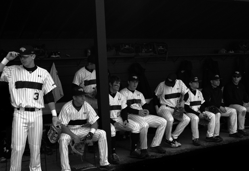 The Towson University baseball team waits for the start of a home game on March 8, 2013 in Baltimore, Md. All the players cover their jerseys with duct tape in protest of the recent decision to terminate the program for the following 2014 season.