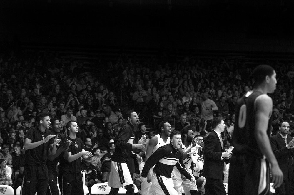 Towson University men's basketball players cannot control their excitement during the last few seconds of their final game of the 2012-2013 season on March 2, 2013 in Baltimore, Md.