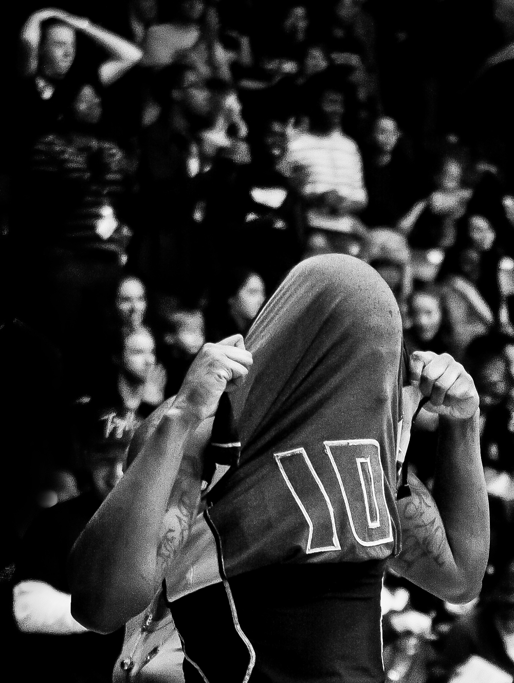Towson University guard Will Adams pulls his jersey over his head in  shame after a tough loss to James Madison University on Feb. 11, 2012 in  Baltimore, Md. From 2011 to 2012 Towson set the NCAA record with 41  consecutive loses.
