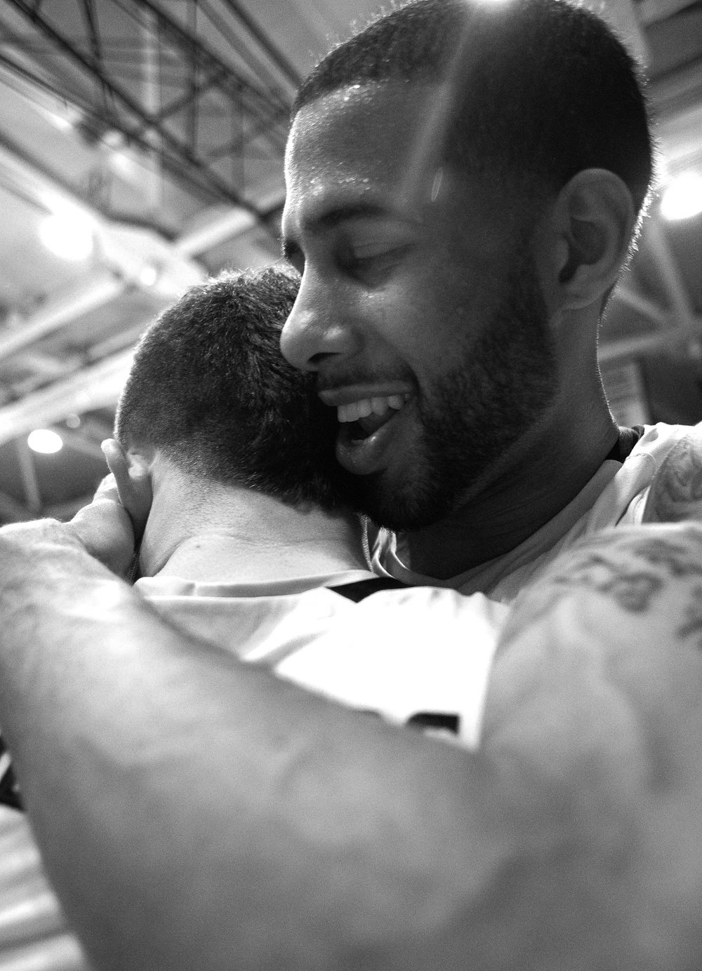 Towson University men's basketball guards Mike Burwell and Brian  Blackstone embrace after a record breaking win over Hofstra University  on March 2, 2013 in Baltimore, Md.