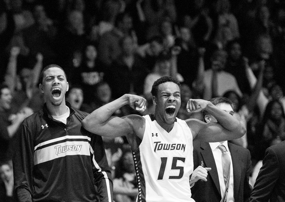 Towson University men's basketball players Jamel Flash and Timajh  Parker-Rivera cheer as they win their final game against Hofstra  University on March 2, 2013 in Baltimore, Md. This game broke the NCAA  record for biggest turn around from a previous season.