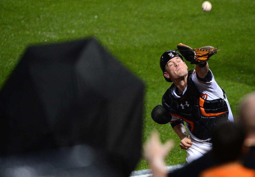 Baltimore Orioles catcher Matt Wieters dives into the stands after a foul ball on June 10, 2013 in Baltimore, Md.