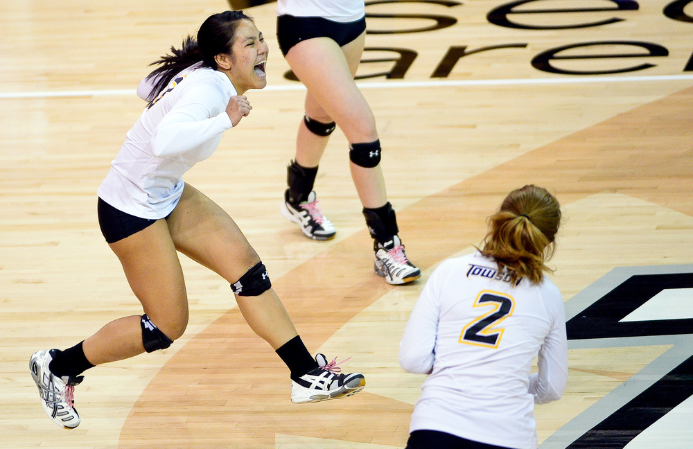 Defensive Specialist Capri Tirrell of Towson University jumps with excitement after saving a rally in their home win over Navy on Nov. 5, 2013 in the SECU Arena.