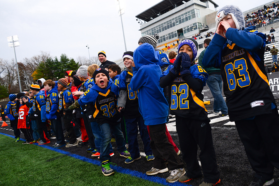 Members of the Lutherville youth football team are invited to help cheer on Towson University during the pregame on Nov. 23, 2013 in Baltimore, Md.