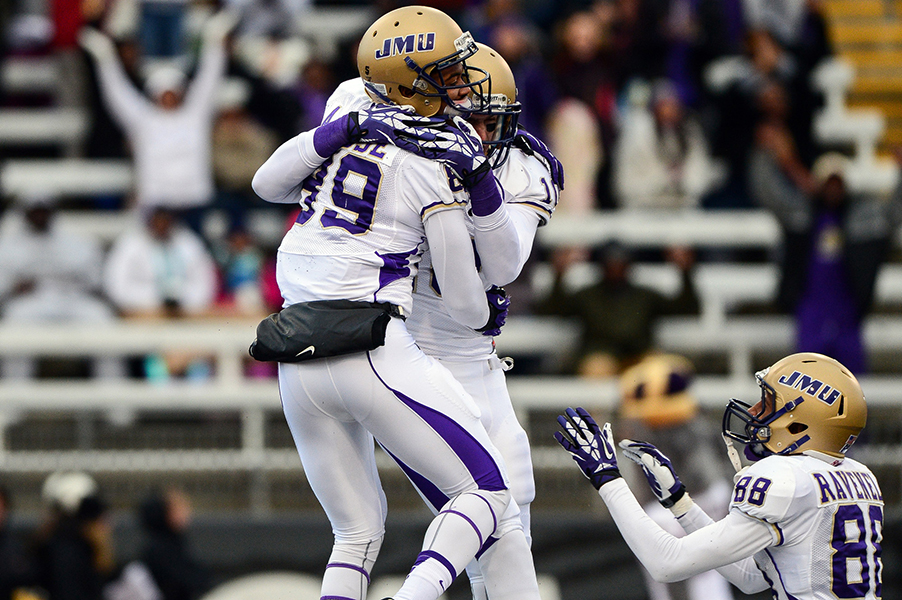 James Madison University wide receiver Anthony Rose celebrates with teammates Brandon Ravenel and Daniel Brow after putting JMU up 7-0 in the first quarter on Nov. 23, 2013 in Baltimore, Md.