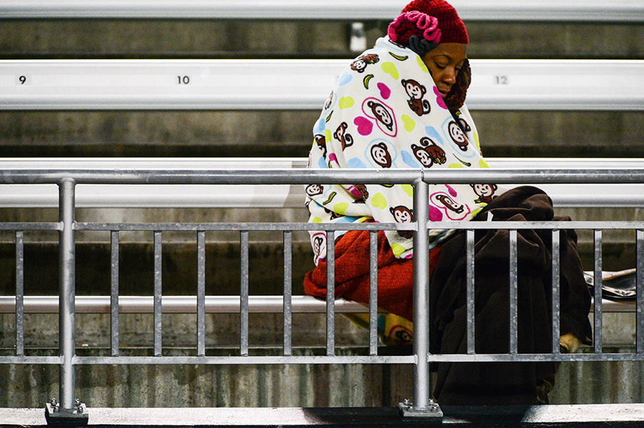 A fan keeps warm with multiple blankets during the Towson University vs. James Madison University football game on Nov. 23, 2013 in Baltimore, Md. Temperatures dropped to 23 degrees driving out most of the fans.