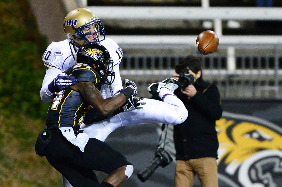 Wide receiver Daniel Brown of James Madison University tries to pull in a pass over top of cornerback Tye Smith of Towson University in the last few minutes of the game on Nov. 23, 2013 in Baltimore, Md.