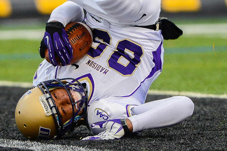 James Madison University wide receiver Anthony Rose slides on his head into the end zone to put JMU up 7-0 in the first quarter on Nov. 23, 2013 in Baltimore, Md.