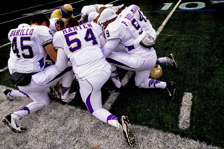 James Madison University football players prepare for a match up against Towson University on Nov. 23, 2013 in Baltimore, Md.