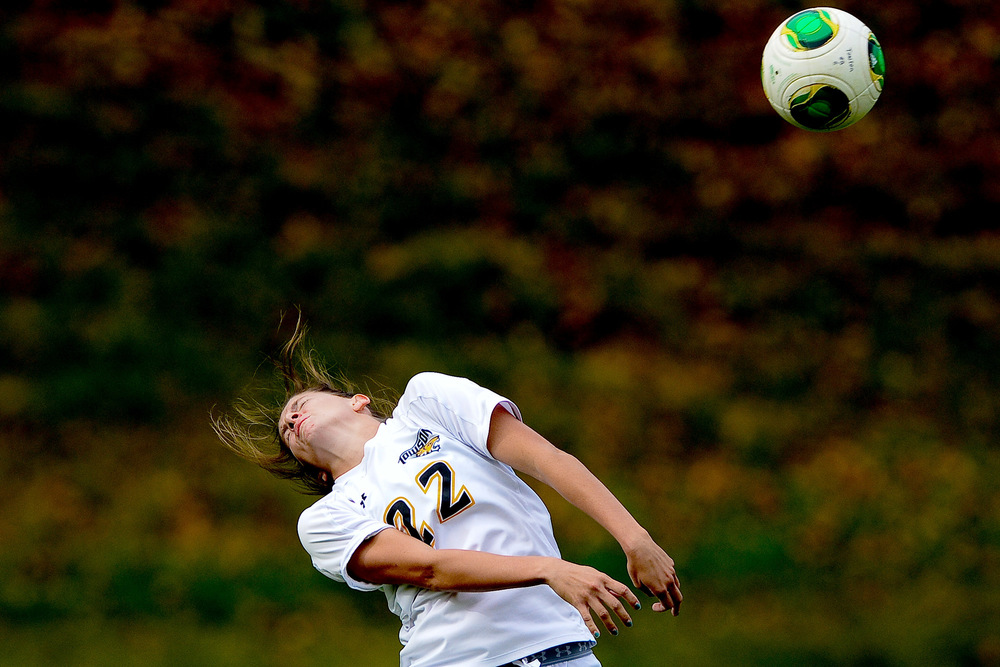 Towson University women's soccer defenseman Alex Evitts attempts a header during a 2-3 loss against Northeastern University on Oct. 17, 2013 in Baltimore, Md.