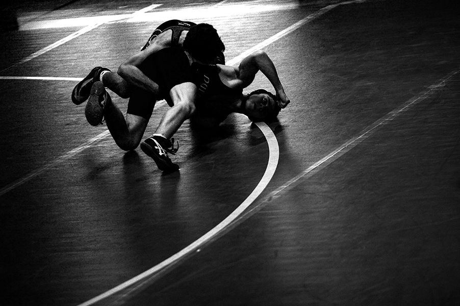 126 pound wrestler Jarrod Martin of Catonsville High School, back, struggles with Dylan Ruiz, front, of Dulaney High School on Dec. 5, 2013 in Timonium, Md.