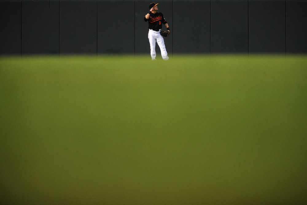 Baltimore Orioles left fielder Nate McLouth waits between plays during a home game against the New York Yankees on June 30, 2013 at Oriole Park at Camden Yards in Baltimore, Md.