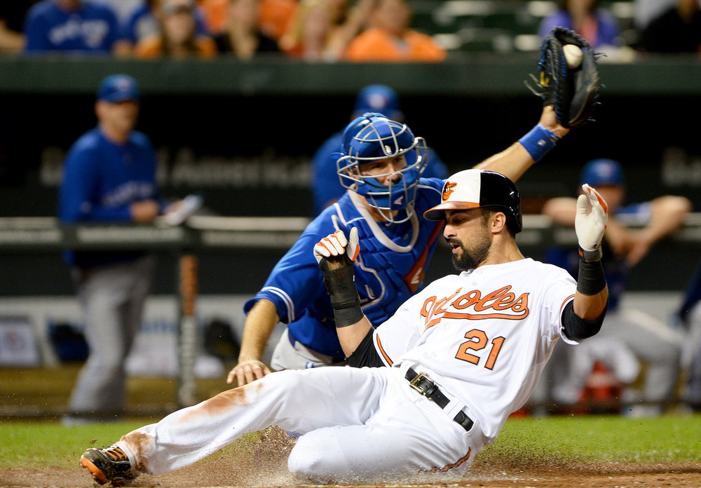Baltimore Orioles right fielder Nick Markakis slides safely home during a home game on Sept. 26, 2013 at Oriole Park at Camden Yards in Baltimore, Md.