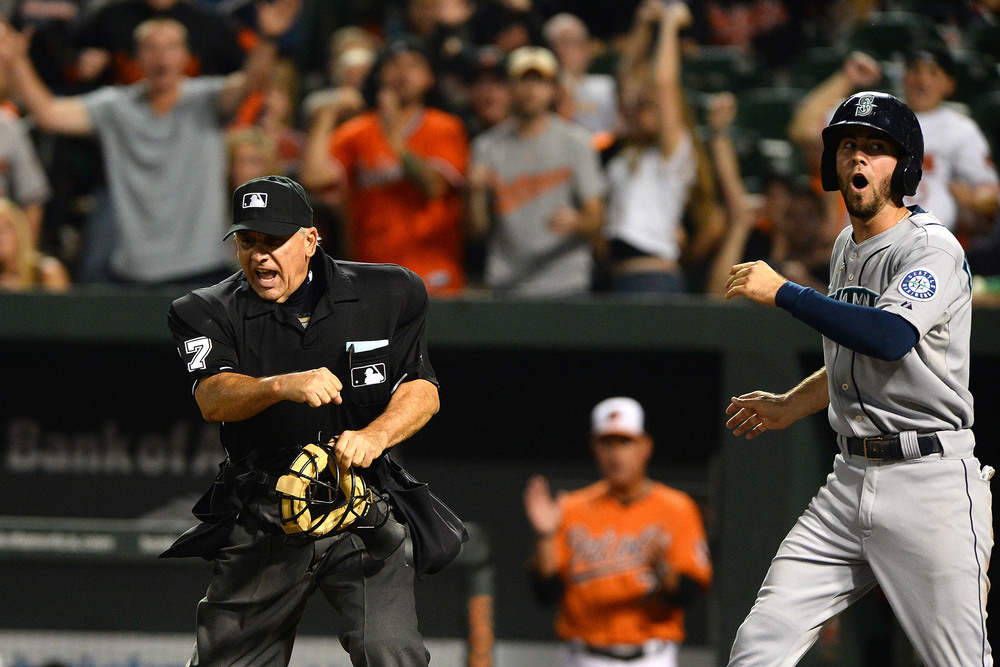 Seattle Mariners first baseman Logan Morrison reacts to being called out at home after sliding into Matt Wieters, not pictured, on Aug. 3, 2013 in Baltimore, Md.