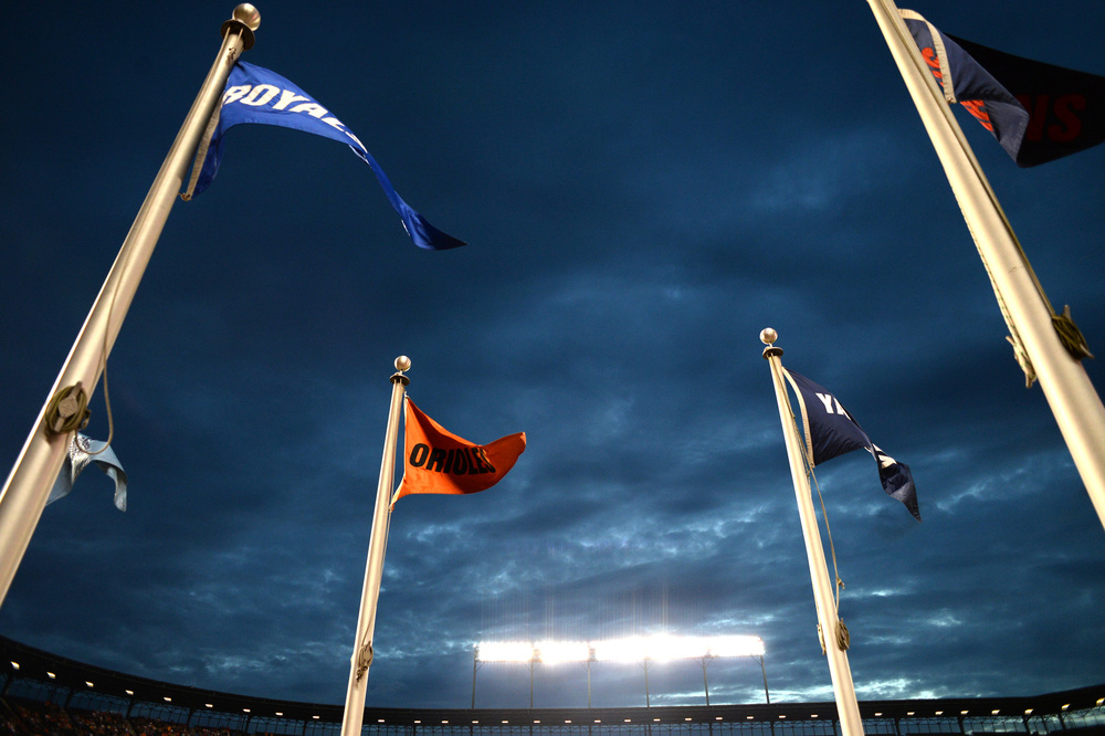 Flags wave in the wind in the flag court at Oriole Park at Camden Yards on June 13, 2013 in Baltimore, Md.