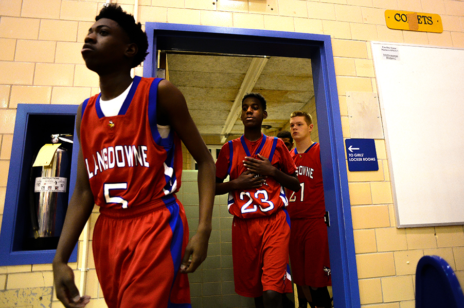 Guard Deshawn Bell, left, center Kyndell Overton and the rest of the Lansdowne High School's basketball team walk out of the locker room before their game at Catonsville High School on Jan. 10, 2014 in Catonsville, Md.
