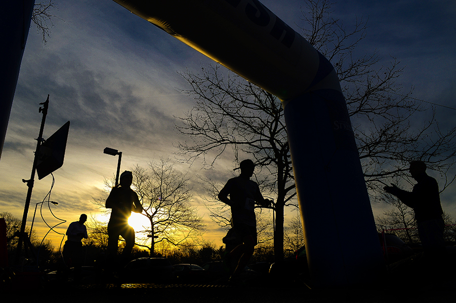Participants cross the finish line of the Penguin Pace 5K at the Bain Center.