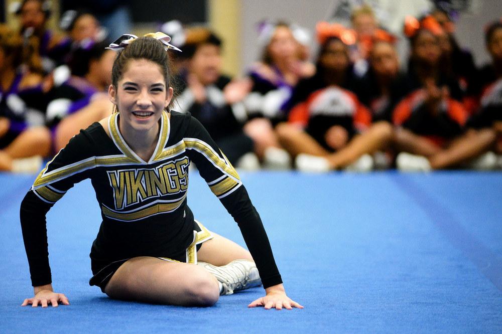 Mount Hebron junior Abby Adelman smiles as her squad finishes their routine.