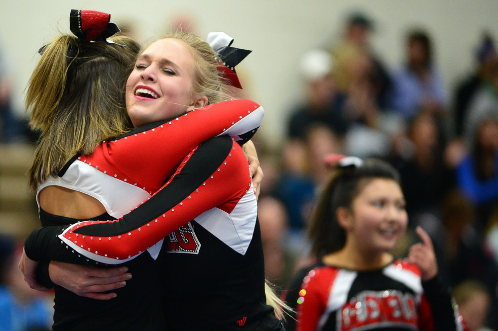 Glenelg senior Hailey Fleece, back, embraces her teammate senior Katherine Greulich after their squad's routine.