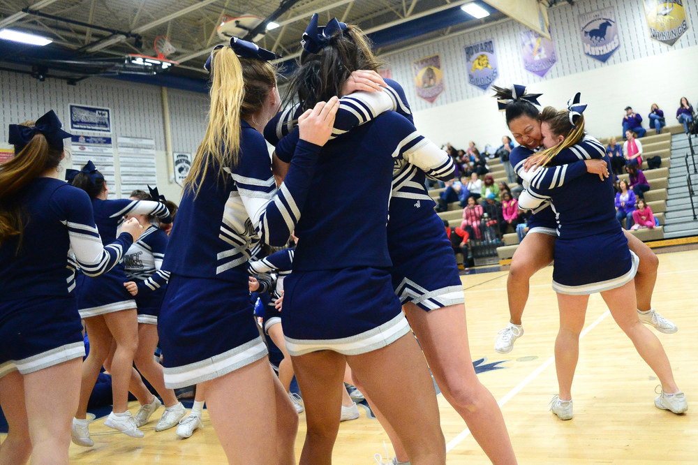 Marriotts Ridge erupts into celebration after winning the Howard County Winter Cheerleading Championships.