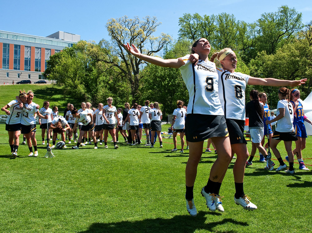 Ashley Waldron, left of Towson University celebrates with her teammate Sarah Maloof after winning the CAA Championship game at Towson University in Baltimore, Maryland on May 5th, 2013.
