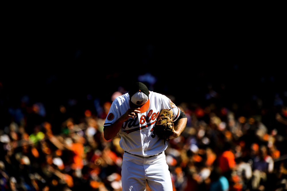 Baltimore Orioles pitcher Chris Tillman prepares himself during a home game against the Boston Redsox on Sept. 29, 2013 in Baltimore, Md.