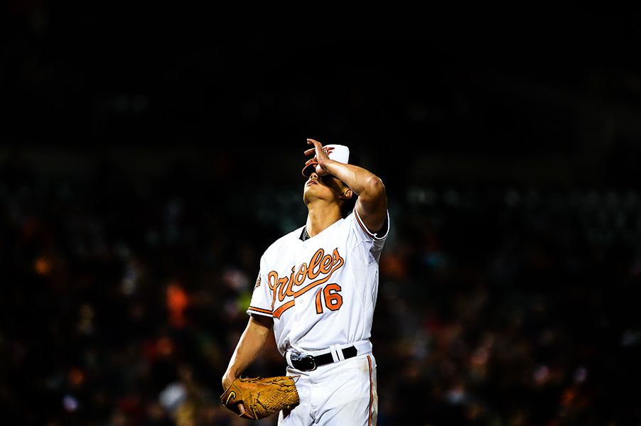 Baltimore Orioles pitcher Wei-Yin Chen adjusts his hat during a game against the Boston Red Sox on April 3, 2014 at Oriole Park in Camden Yards in Baltimore, Md.