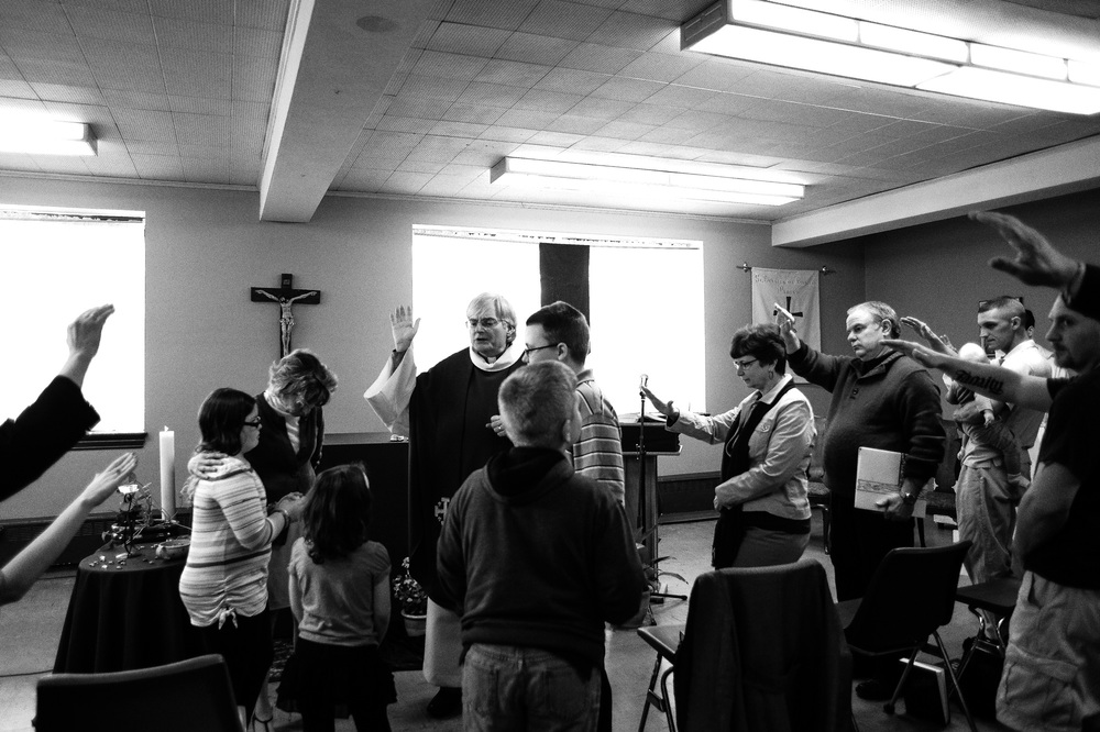 The congregation dismisses the children to a separate religious lesson during the fifth Sunday of Lent service at Saint Charles of Brazil Parish on April 6, 2014 in Arbutus, Maryland.