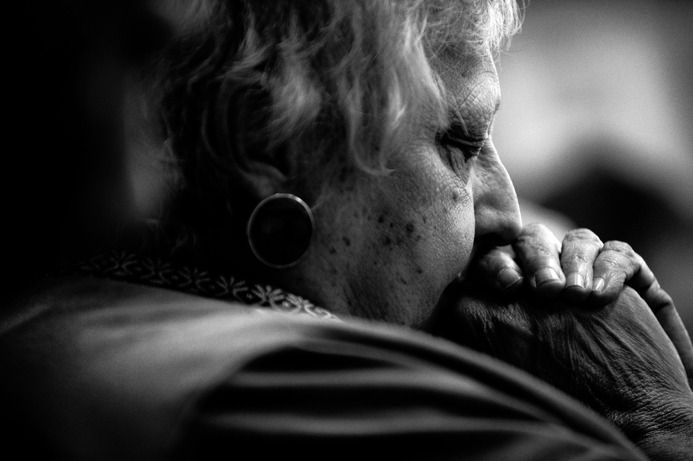 Pat Gurbelski of Violetville takes a moment to reflect during the fifth Sunday of Lent service at Saint Charles of Brazil Parish on April 6, 2014 in Arbutus, Maryland.
