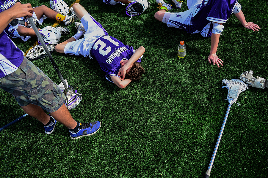 Long Reach's Anthony Valenza, center, takes a break at halftime during a game against Glen Burnie on April 19, 2014 in Columbia, Md.