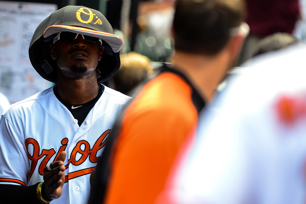 Adam Jones of the Baltimore Orioles wears the Orioles' Mascot's hat during a home game on June 2, 2013 in Baltimore, Md.