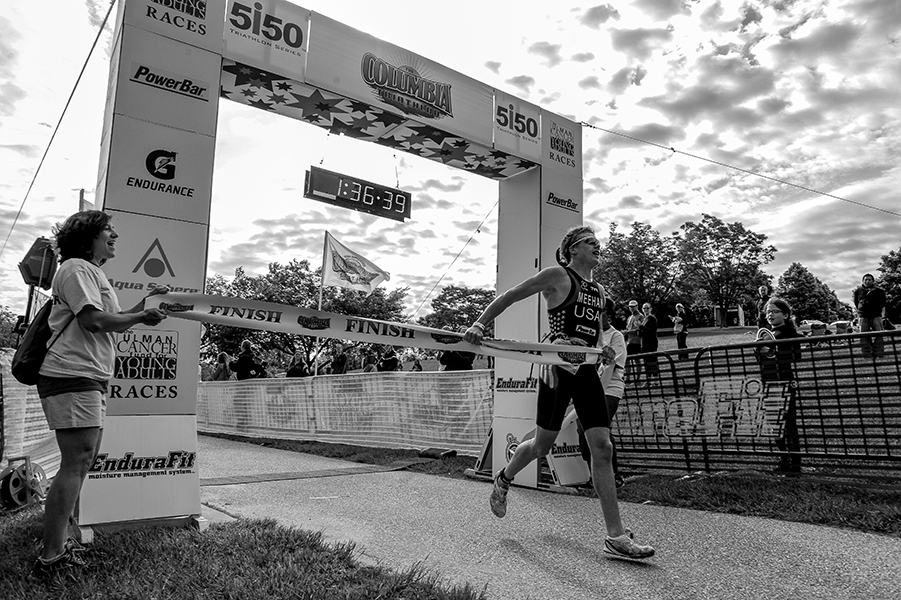 Mike Meehan of Pittsburgh, Pennsylvania, finishes first in the men's amateur category at the 31st annual Columbia Triathlon on May 18, 2014 in Centennial Park in Ellicott City, Maryland.