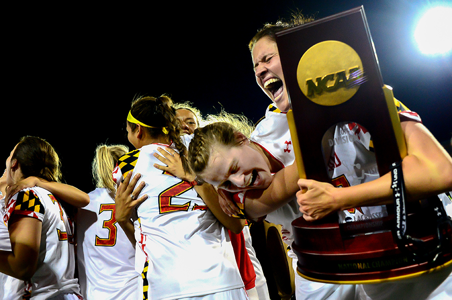 Kelly McPartland, left, of University of Maryland embraces her teammate Shanna Brady after defeating Syarcuse 15-12 in  an NCAA championship lacrosse game Sunday, May 25, 2014, in Towson, Maryland.