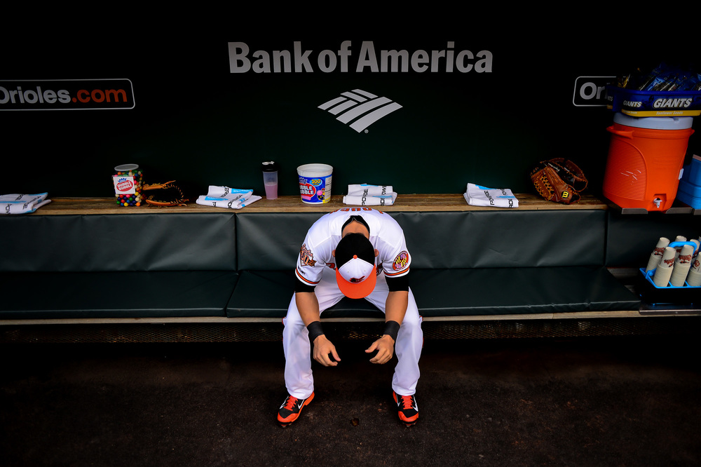 David Lough of the Baltimore Orioles sits in the dugout before a game against the Tampa Bay Rays at Oriole Park at Camden Yards in Baltimore, Md. on April 14, 2014.