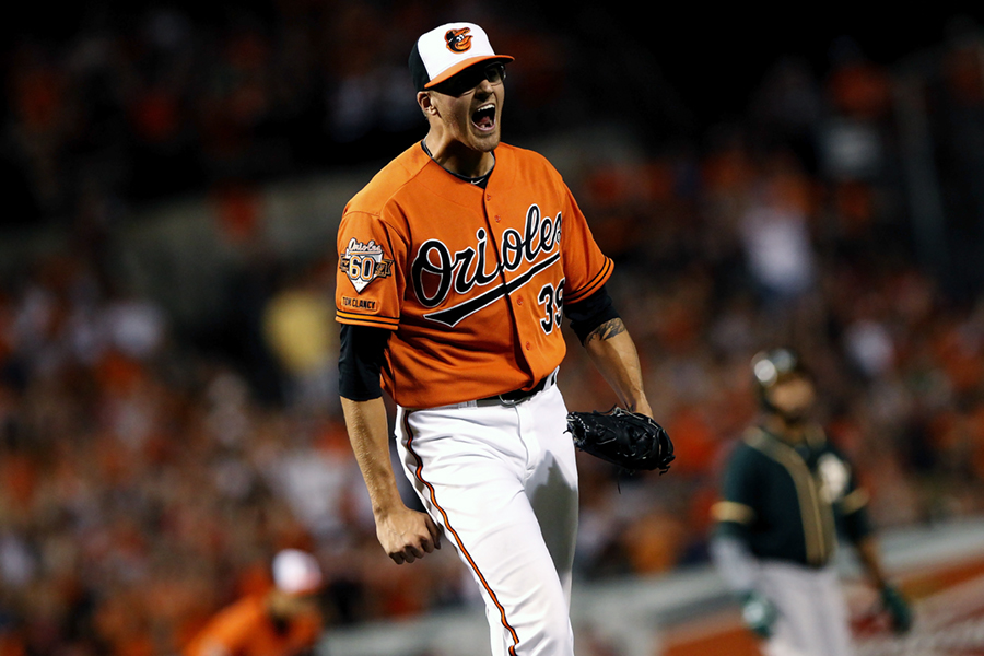 Baltimore Orioles starting pitcher Kevin Gausman yells with excitement after throwing the final strike of the 7th inning during a game against the Oakland Athletics on June 7, 2014 at Oriole Park at Camden Yards in Baltimore, Maryland.