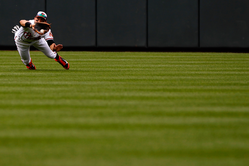 Baltimore Orioles center fielder David Lough makes the catch during a game against the Oakland Athletics on June 8, 2014 at Oriole Park at Camden Yards in Baltimore, Maryland.