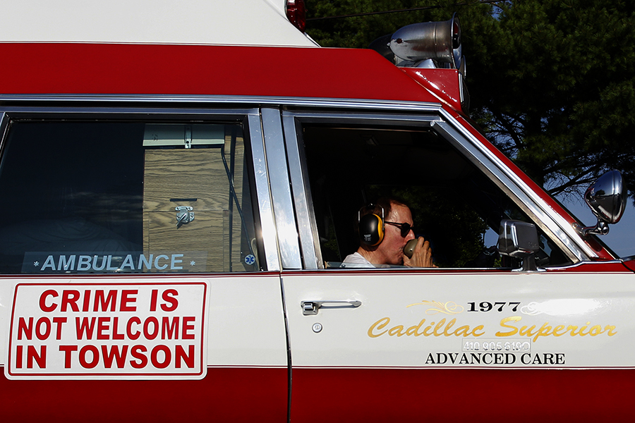 "Wesley Wood of Campus Hills uses an intercom system to say ""Crime is Not Welcome in Towson"" during National Night Out in Towson, MD on August 5, 2014."