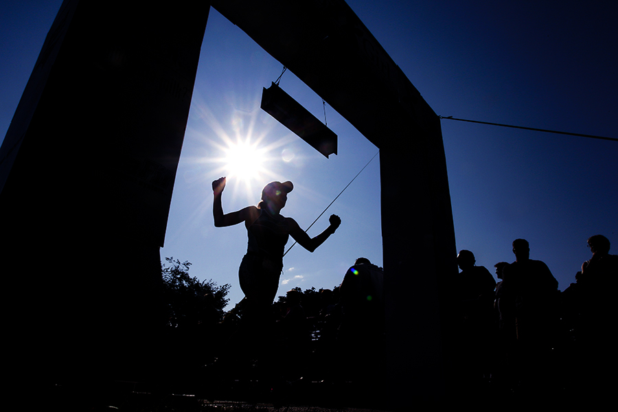 Cynthia Stele of Germantown celebrates as she crosses the finish line at the Iron Girl Triathlon in Ellicott City on August 17, 2014.