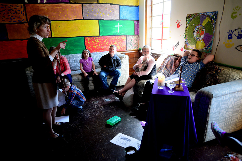 Ruth Wickless, left, of Arbutus teaches the children of the congregation at a  separate religious lesson during the fifth Sunday of Lent service at Saint Charles of Brazil Parish on April 6, 2014 in Arbutus, Md.