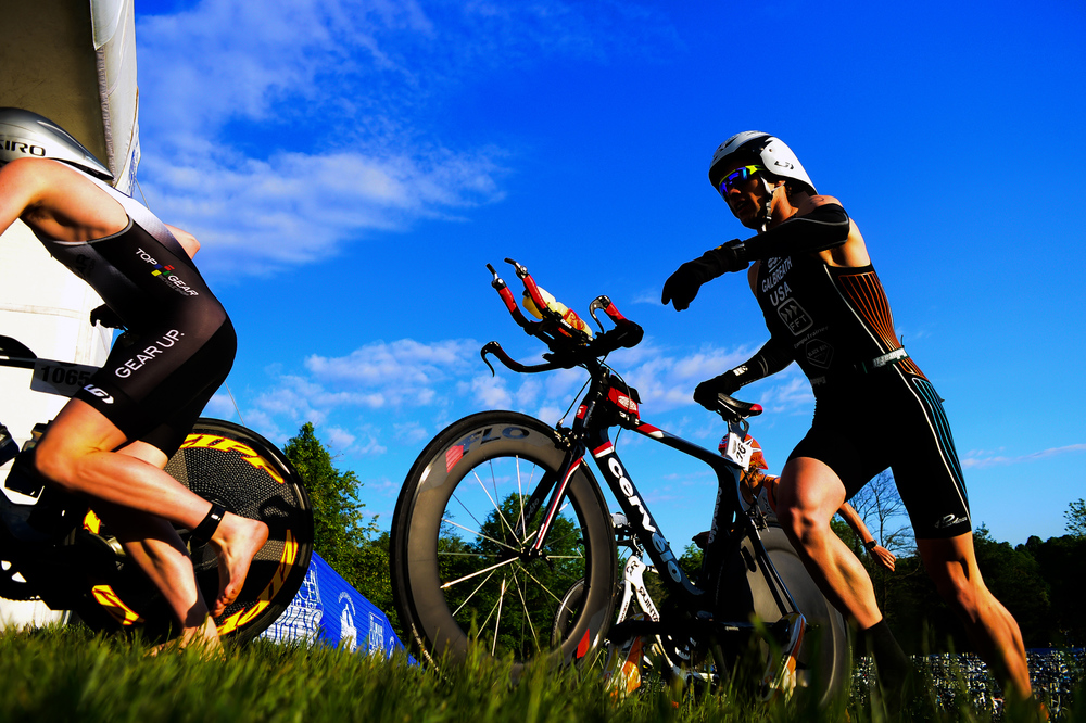 Justin Galbreath, right, of Coatesville, Pennsylvania races his bike up a hill during the 31st annual Columbia Triathlon at Centennial Park in Ellicott City, Maryland on May 18, 2014.