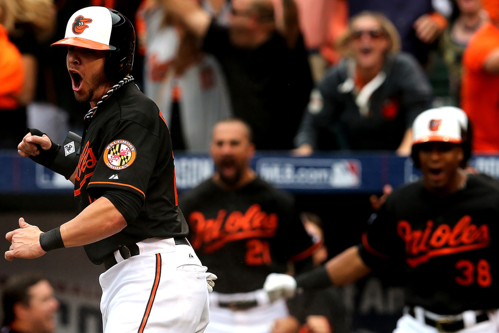 Baltimore Orioles first baseman Steve Pearce celebrates after Delmon Young hit a double during Game Two of the American League Division Series against the Detroit Tigers at Oriole Park at Camden Yards on October 3, 2014 in Baltimore, Maryland.