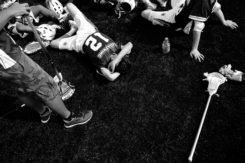 Anthony Valenza of Long Reach High School rests during halftime during a boy's lacrosse game against Wilde Lake High School on April 19, 2014 in Columbia, Maryland.