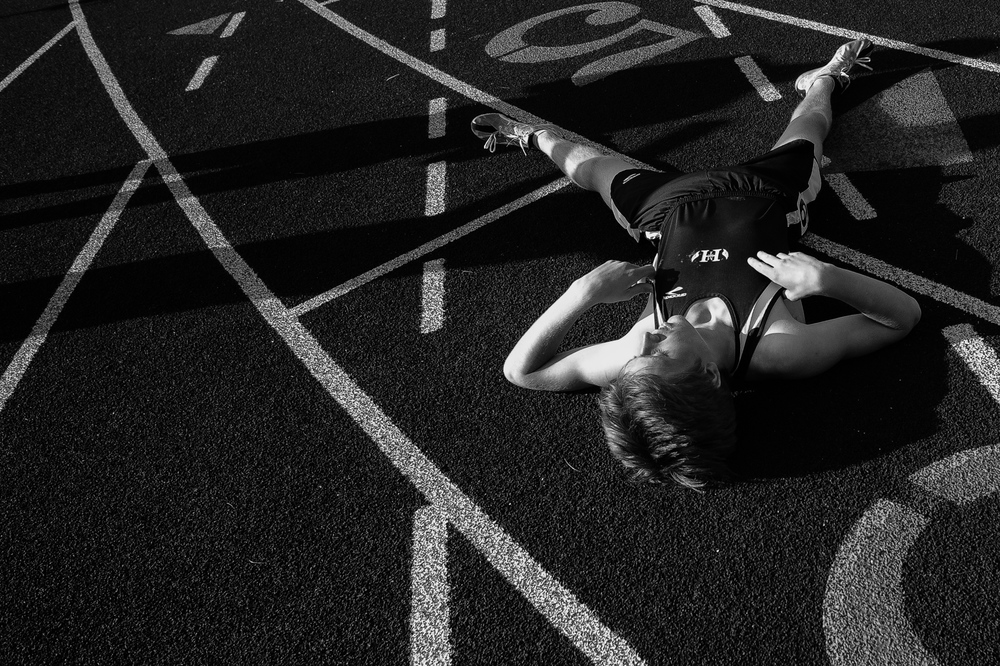 Gregory Bisant of Mount Hebron High School collapses on the track after the 800 meter run during the second day of the Howard County Track Championships at Wilde Lake High School in Columbia, Maryland on May 6, 2014.
