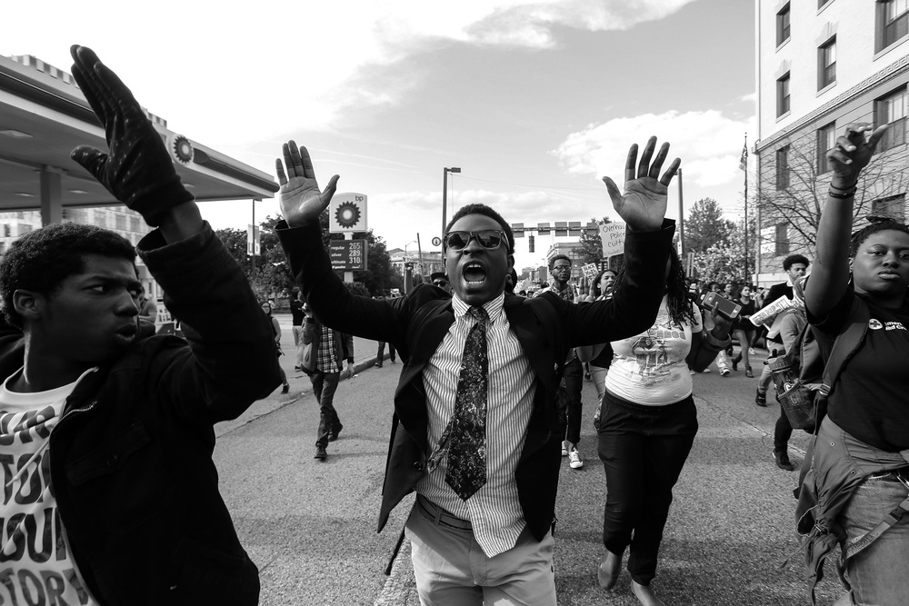Protestors march down St. Paul Street in response to the death of Freddie Gray while he was held in police custody,  April 29, 2015 in Baltimore, Maryland.