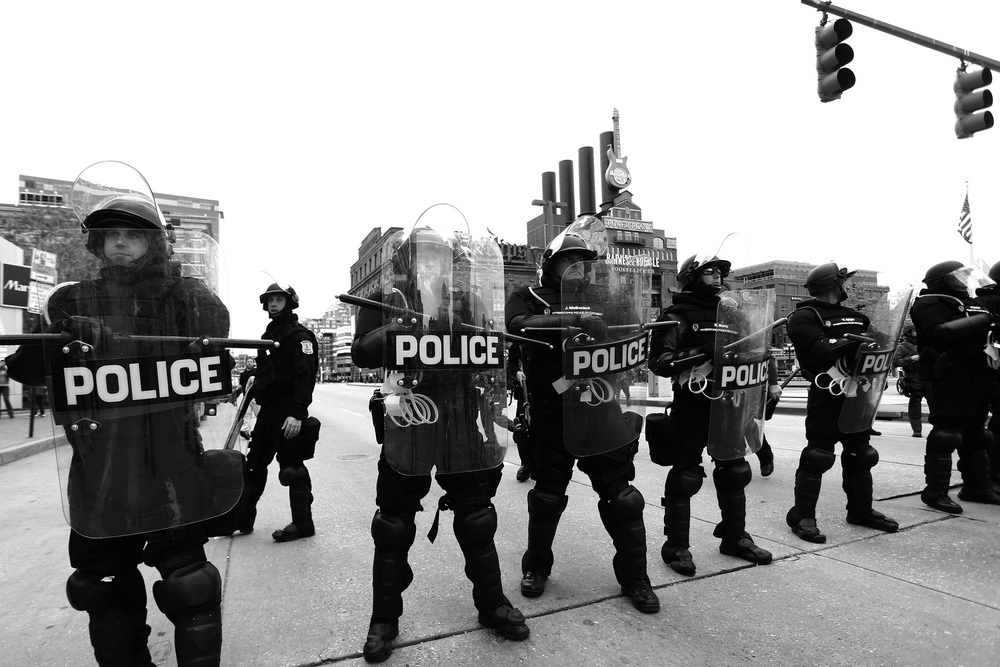 Police officers make a barrier at the intersection of Pratt Street and Calvert Street while protestors march after the announcement that all six officers will be charged following the death of Freddie Gray while he was in police custody,  May 1, 2015 in Baltimore, Maryland.
