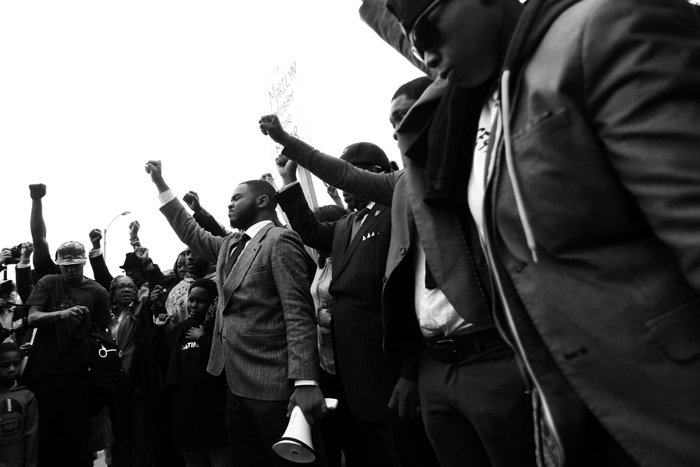Protestors pray before beginning a march around the Baltimore City Detention Center on  401 E. Eager Street after the announcement that all six officers will be charged following the death of Freddie Gray while he was in police custody,  May 1, 2015 in Baltimore, Maryland.