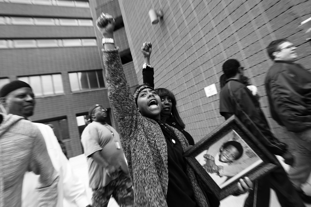 Protestors march around the Baltimore City Detention Center on  401 E. Eager Street after the announcement that all six officers will be charged following the death of Freddie Gray while he was in police custody,  May 1, 2015 in Baltimore, Maryland.